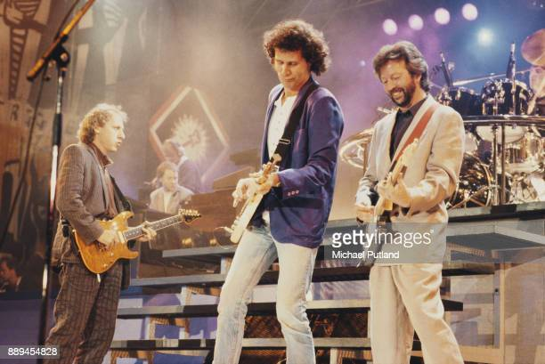 Musicians Mark Knopfler and John Illsley of Dire Straits performing with Eric Clapton at the 70th birthday tribute concert for imprisoned South...
