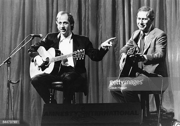 Musicians Mark Knopfler of the band 'Dire Straits' and Chet Atkins performing on stage at 'The Secret Policeman's Ball' at the London Palladium March...