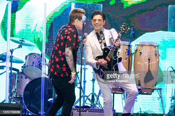 Musicians Mark McGrath and John Stamos of The Beach Boys perform on stage at PETCO Park on May 29, 2021 in San Diego, California.
