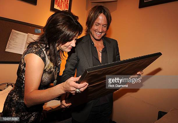 Musicians Martina McBride and Keith Urban speak backstage during the 4th Annual ACM Honors at the Ryman Auditorium on September 20 2010 in Nashville...