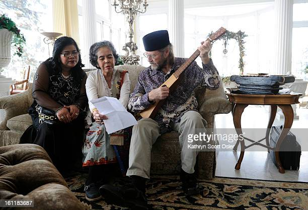 Musicians Masnur Tambunan left Lucia Erwina Silalahi and Saleh Lawrence Frey right representing ARCINDA play Christmas music in the main living room...