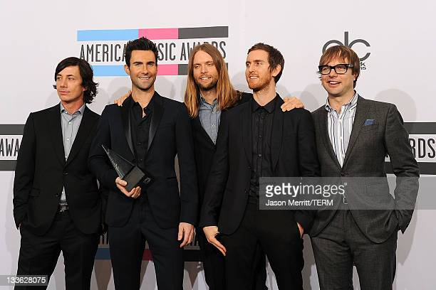 Musicians Matt Flynn Adam Levine James Valentine Jesse Carmichael and Mickey Madden pose in the press room at the 2011 American Music Awards held at...