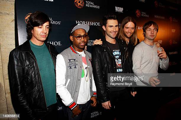 Musicians Matt Flynn PJ Morton Adam Levine James Valentine and Michael Madden of Maroon 5 poses for photos on the red carpet for the Escape To Total...