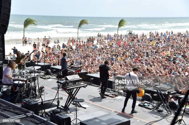 Musicians Matt Frazier Nik Ewing Kelcey Ayer Taylor Rice and Ryan Hahn of the band Local Natives perform at the Surf Stage during 2017 Hangout Music...