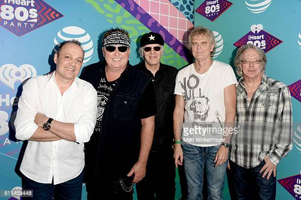 Musicians Matt Frenette Mike Reno Paul Dean Doug Johnson and Ken Spider Sinnaeve of Loverboy pose backstage during the first ever iHeart80s Party at...