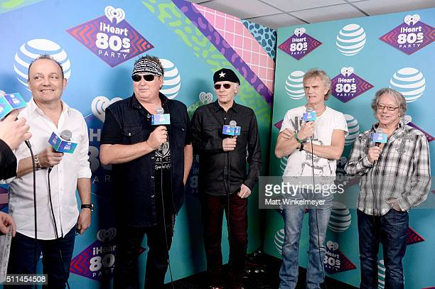 Musicians Matt Frenette Mike Reno Paul Dean Doug Johnson and Ken Spider Sinnaeve of Loverboy speak backstage during the first ever iHeart80s Party at...