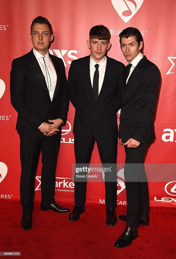 Musicians Matt Helders, Jamie Cook, and Alex Turner of Arctic Monkeys attend the 25th anniversary MusiCares 2015 Person Of The Year Gala honoring Bob Dylan at the Los Angeles Convention Center on February 6, 2015 in Los Angeles, California. The annual benefit raises critical funds for MusiCares' Emergency Financial Assistance and Addiction Recovery programs. For more information visit musicares.org.