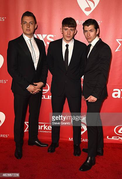 Musicians Matt Helders Jamie Cook and Alex Turner of Arctic Monkeys attend the 25th anniversary MusiCares 2015 Person Of The Year Gala honoring Bob...