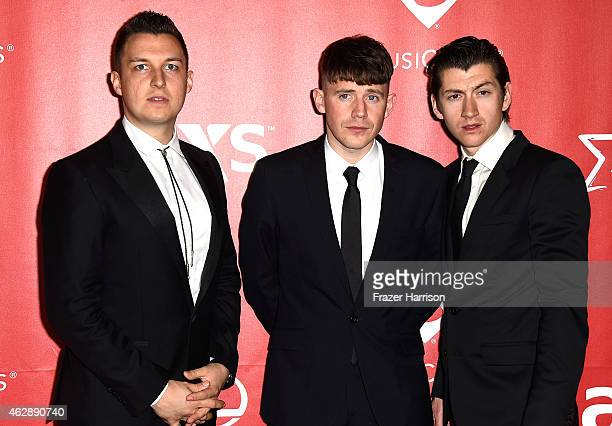 R Musicians Matt Helders Jamie Cook and Alex Turner of Arctic Monkeys attend the 25th anniversary MusiCares 2015 Person Of The Year Gala honoring Bob...