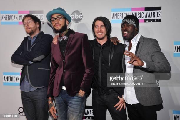Musicians Matt McGinley Travie McCoy Eric Roberts and Disashi LumumbaKasongo of Gym Class Heroes arrive at the 2011 American Music Awards held at...