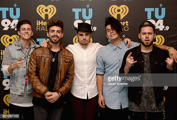 Musicians Matt Rey Hector Rodriguez Juan Pablo Ismael Cano and Tomas Slemenson of Los 5 pose backstage during the iHeartRadio Fiesta Latina Red...