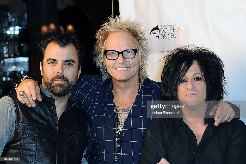 Musicians Matt Sorum (2nd from L) and Steve Stevens (3rd from L) arrive at the Avalon for Kings of Chaos Tokyo Celebrates The Dolphin Benefit Concert on November 18, 2013 in Hollywood, California.