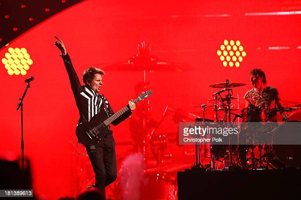 Musicians Matthew Bellamy and Dominic Howard of the band Muse perform onstage during the iHeartRadio Music Festival at the MGM Grand Garden Arena on...