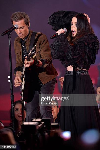 Musicians Matthew Koma and Miriam Bryant perform onstage at the 2014 MTV Movie Awards at Nokia Theatre L.A. Live on April 13, 2014 in Los Angeles,...