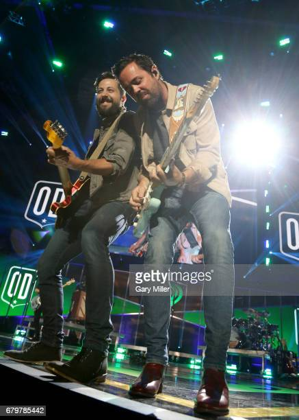 Musicians Matthew Ramsey and Brad Tursi of Old Dominion perform onstage during the 2017 iHeartCountry Festival A Music Experience by ATT at The Frank...
