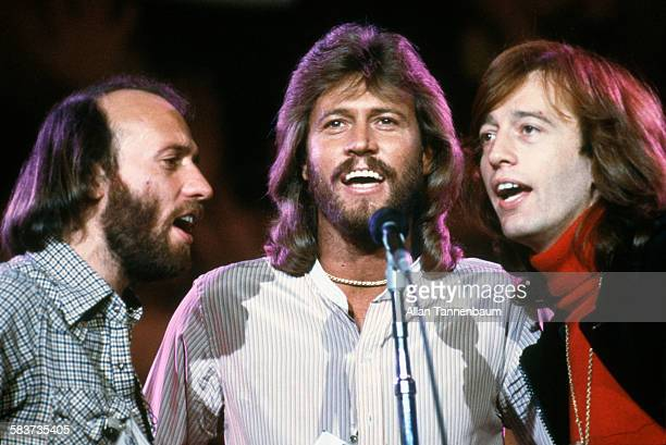 Musicians Maurice Barry and Robin Gibb of the group the Bee Gees sing at a benefit concert for UNICEF at the UN HQ New York New York January 9 1979