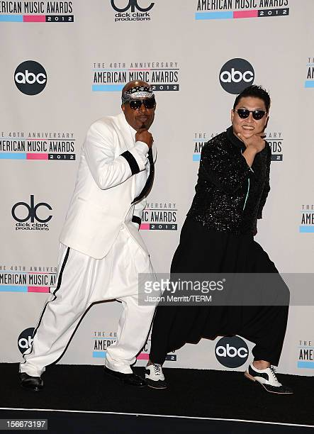 Musicians MC Hammer and Psy pose in the press room at the 40th American Music Awards held at Nokia Theatre LA Live on November 18 2012 in Los Angeles...