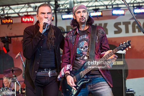 Musicians Mel Schacher and Max Carl of Grand Funk Railroad perform on stage at the San Diego County Fair on July 5 2014 in Del Mar California