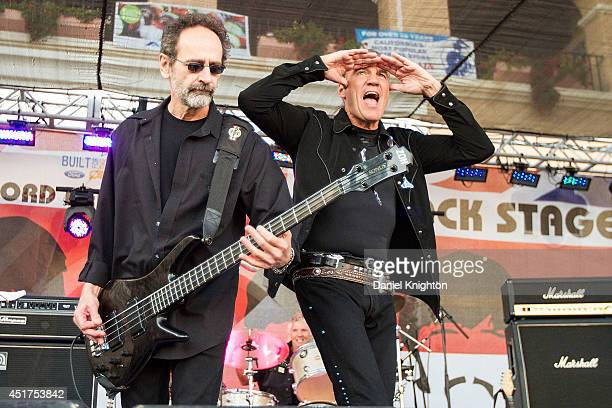 Musicians Mel Schacher and Max Carl of Grand Funk Railroad performs on stage at the San Diego County Fair on July 5 2014 in Del Mar California
