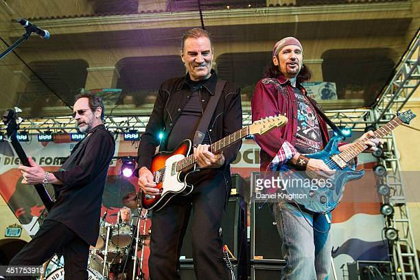 Musicians Mel Schacher Max Carl and Bruce Kulick of Grand Funk Railroad perform on stage at the San Diego County Fair on July 5 2014 in Del Mar...