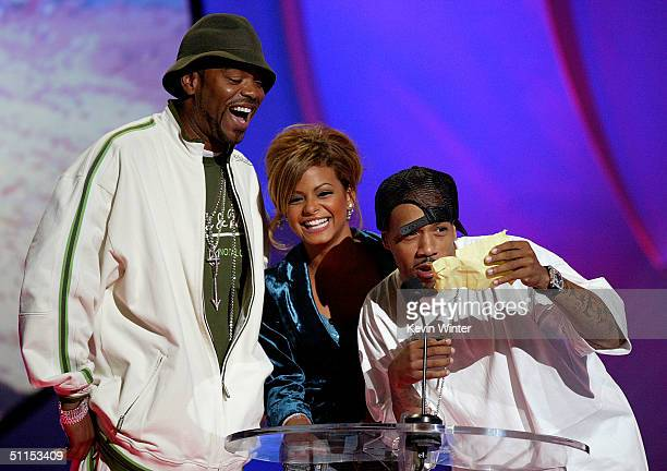 Musicians Method Man Christina Milian and Redman present the Choice Single award on stage at The 2004 Teen Choice Awards held at Universal...