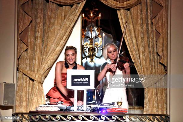 Musicians Mia Moretti and Caitlin Moe of the Dolls perform during the 4th Annual amfAR Inspiration Gala New York at The Plaza Hotel on June 13 2013...