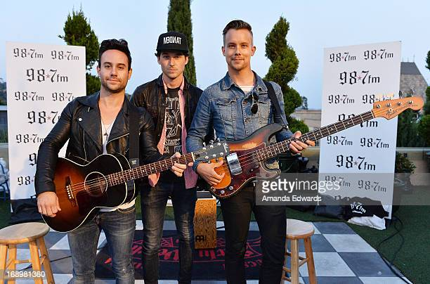 Musicians Michael Bruno Alexander Noyes and Andrew Lee Schmidt of the band Honor Society pose before performing onstage at the OvertureCon launch...
