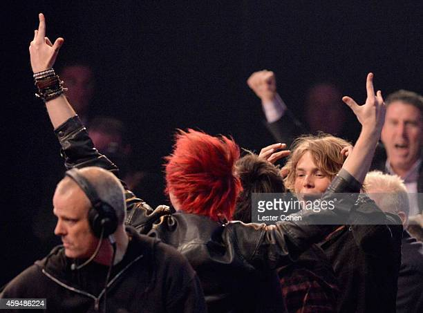 Musicians Michael Clifford and Ashton Irwin of 5 Seconds of Summer speak onstage at the 2014 American Music Awards at Nokia Theatre LA Live on...