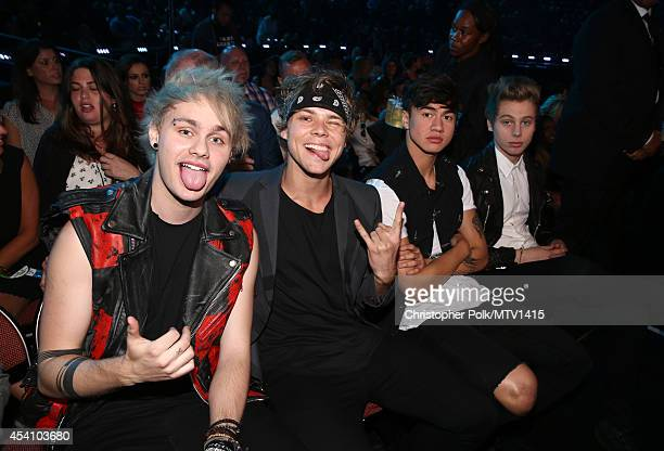 Musicians Michael Clifford Ashton Irwin Calum Hood and Luke Hemmings of 5 Seconds of Summer attend the 2014 MTV Video Music Awards at The Forum on...