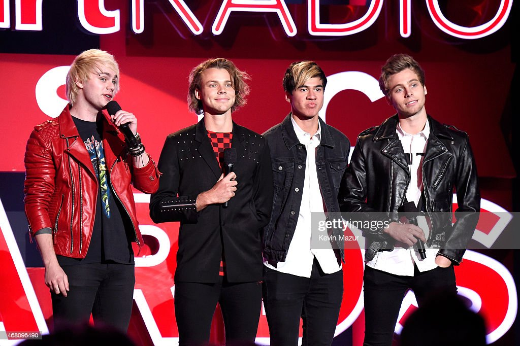 Musicians Michael Clifford, Ashton Irwin, Calum Hood, and Luke Hemmings of 5 Seconds of Summer speak onstage during the 2015 iHeartRadio Music Awards which broadcasted live on NBC from The Shrine Auditorium on March 29, 2015 in Los Angeles, California.