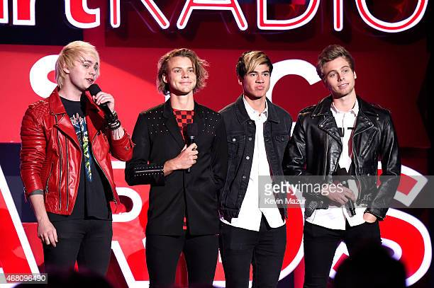 Musicians Michael Clifford Ashton Irwin Calum Hood and Luke Hemmings of 5 Seconds of Summer speak onstage during the 2015 iHeartRadio Music Awards...