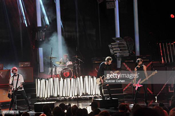 Musicians Michael Clifford, Ashton Irwin, Luke Hemmings and Calum Hood of 5 Seconds of Summer perform onstage at the 2014 American Music Awards at...