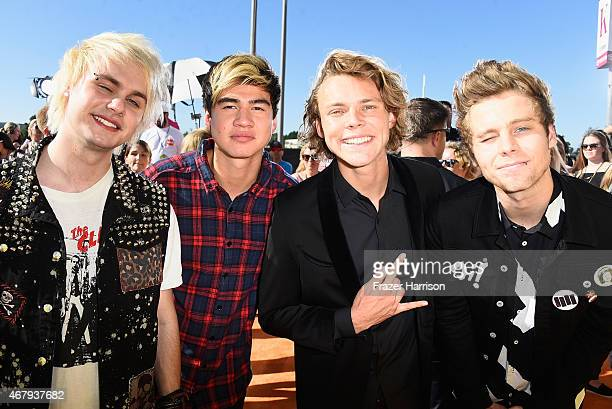 Musicians Michael Clifford Calum Hood Ashton Irwin and Luke Hemmings of 5 Seconds of Summer attend Nickelodeon's 28th Annual Kids' Choice Awards held...