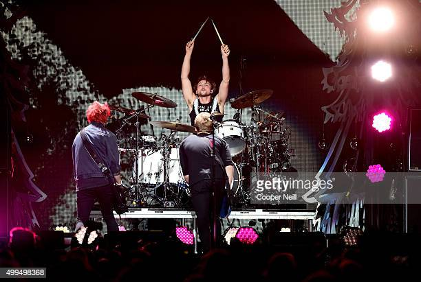 Musicians Michael Clifford, Luke Hemmings, and Ashton Irwin of 5 Seconds of Summer perform onstage during 106.1 KISS FM's Jingle Ball 2015 presented...