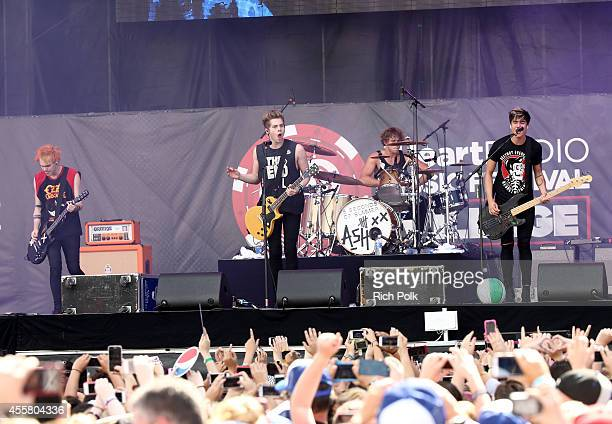 Musicians Michael Clifford Luke Hemmings Ashton Irwin and Calum Hood of 5 Seconds of Summer perform onstage during the 2014 iHeartRadio Music...