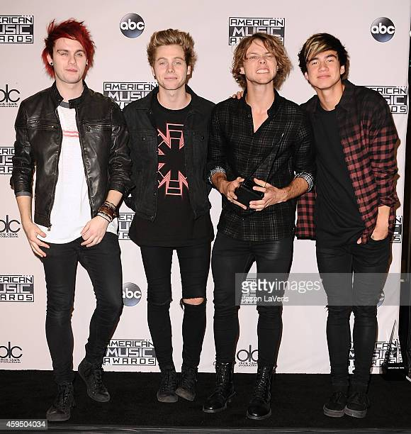 Musicians Michael Clifford Luke Hemmings Ashton Irwin and Calum Hood of 5 Seconds of Summer poses in the press room at the 2014 American Music Awards...