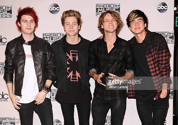 Musicians Michael Clifford, Luke Hemmings, Ashton Irwin and Calum Hood of 5 Seconds of Summer poses in the press room at the 2014 American Music...