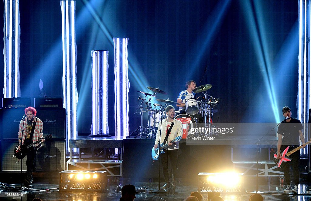 Musicians Michael Clifford, Luke Hemmings, Ashton Irwin, and Calum Hood of 5 Seconds of Summer perform onstage during the 2015 American Music Awards at Microsoft Theater on November 22, 2015 in Los Angeles, California.
