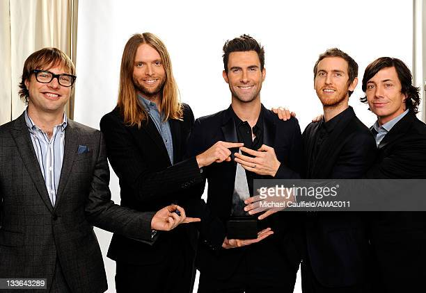Musicians Michael Madden James Valentine Adam Levine Jesse Carmichael and Matt Flynn of Maroon 5 pose for a portrait at the 2011 American Music...
