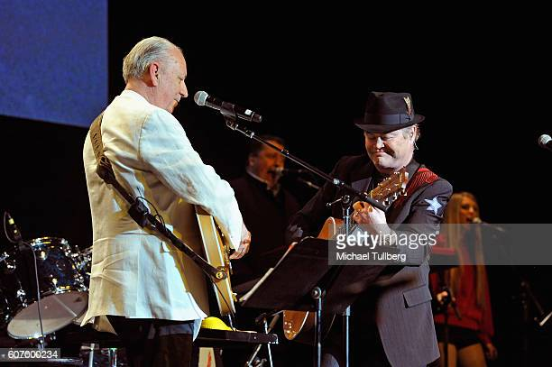 Musicians Michael Nesmith and Micky Dolenz of The Monkees perform at the Pantages Theatre on September 16 2016 in Hollywood California