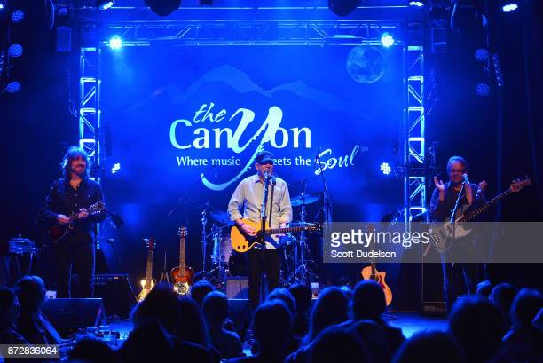 Musicians Michael Webb Rusty Young and Jack Sundrud of the band Poco perform onstage at The Canyon Club on November 10 2017 in Agoura Hills California