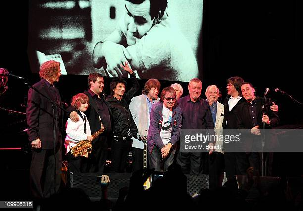 Musicians Mick Hucknall Tom Waters Ben Waters Ronnie Wood Mick Taylor Bill Wyman Charlie Watts Dave Green Hamish Maxwell Axel Zwingenberger and Jools...