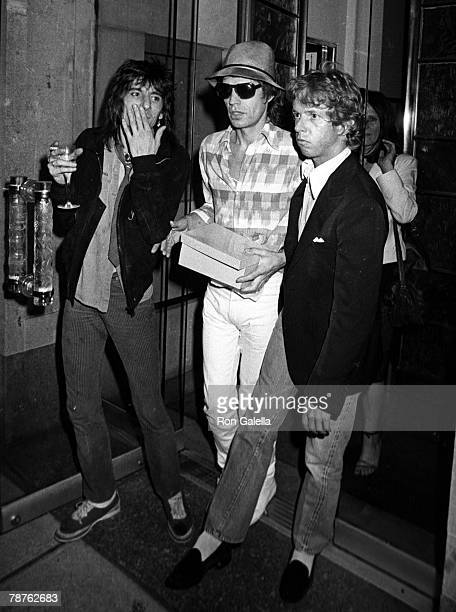 Musicians Mick Jagger and Ron Wood of The Rolling Stones attending 'Birthday Party for Jerry Hall' on July 2 1981 at Mr Chow's Restaurant in New York...