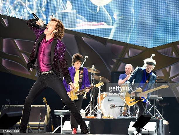 Musicians Mick Jagger Ronnie Wood Charlie Watts and Keith Richards of The Rolling Stones perform to a sold out crowd during the kick off concert of...
