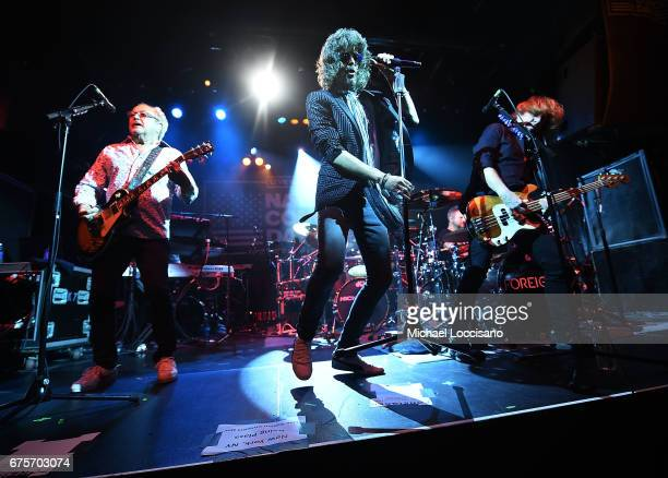 Musicians Mick Jones Kelly Hansen and Jeff Pilson of Foreigner perform during Live Nation's celebration of The 3rd Annual National Concert Day at...