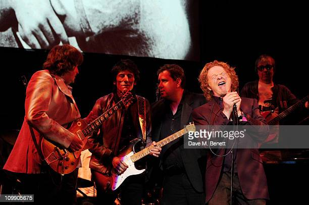 Musicians Mick Taylor Ronnie Wood Ben Waters Mick Hucknall and Bill Wyman perform at 'Boogie for Stu A Tribute to Ian Stewart' a charity concert in...