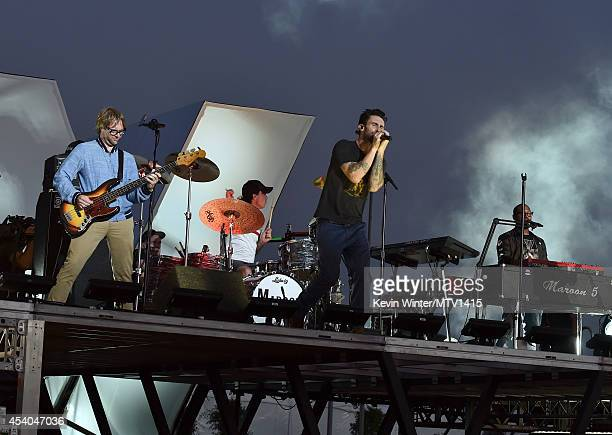 Musicians Mickey Madden Matt Flynn Adam Levine and PJ Morton of the band Maroon 5 perform onstage during rehearsals for the 2014 MTV Video Music...