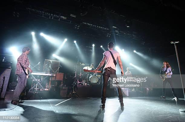 Musicians Mickey Madden Matt Flynn Adam Levine Jesse Carmichael and James Valentine of Maroon 5 perform onstage at the truTV Upfront 2011 at Best Buy...