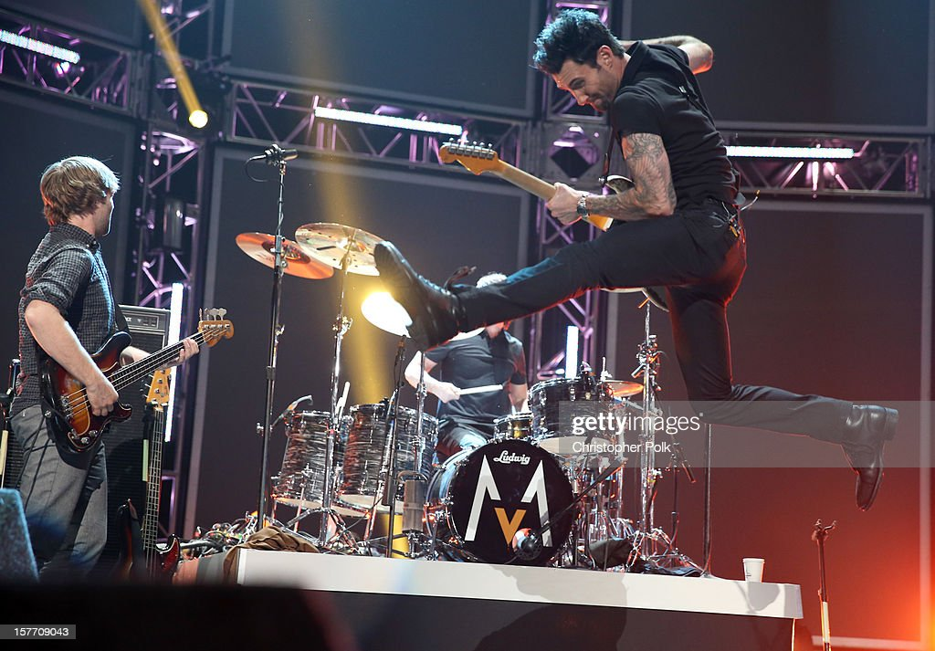 Musicians Mickey Madden, Matt Flynn and Adam Levine of Maroon 5 perform onstage at The GRAMMY Nominations Concert Live!! held at Bridgestone Arena on December 5, 2012 in Nashville, Tennessee.