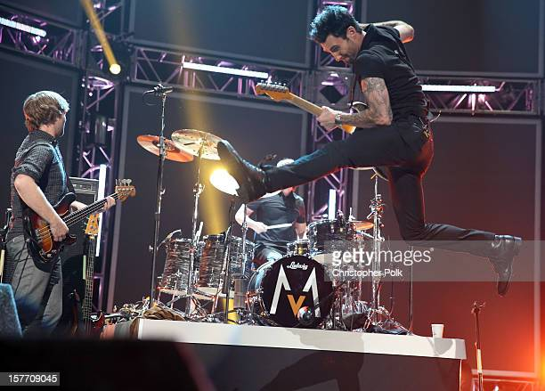 Musicians Mickey Madden Matt Flynn and Adam Levine of Maroon 5 perform onstage at The GRAMMY Nominations Concert Live held at Bridgestone Arena on...
